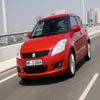 Red Suzuki Swift 2011